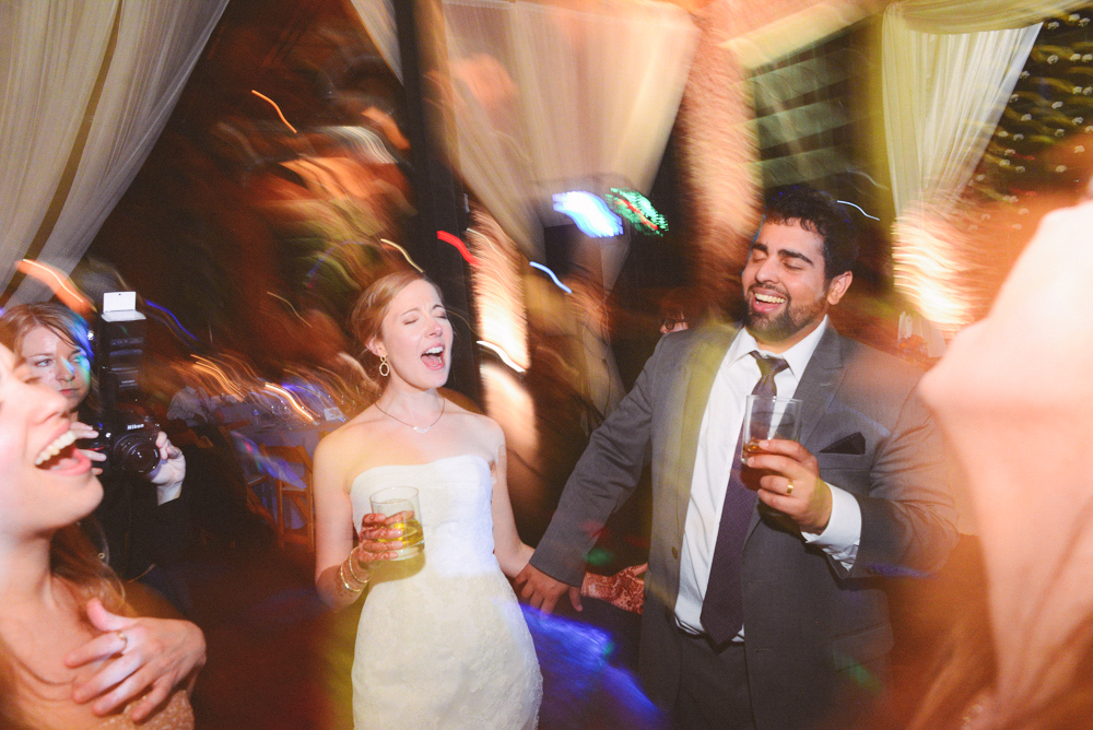 A happy couple smile during their reception at the Foundry at Puritan Mill